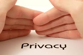 Hands covering over the word privacy